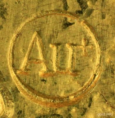 Au Logo auf Gold
