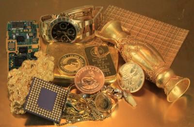 Altes Gold mit Anlagemünzen